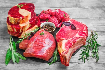 Different types of red meat on round board