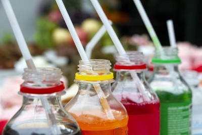 carbonated soft drink soda bottles with plastic straw
