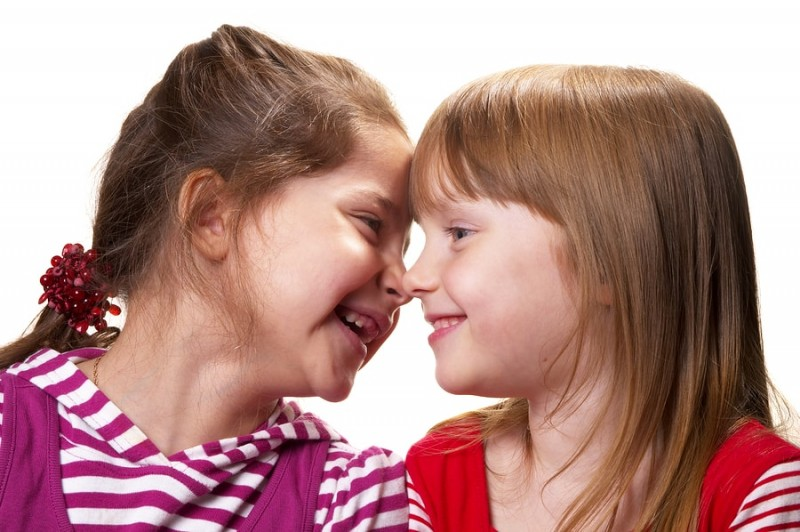 two little girls laughing with each other