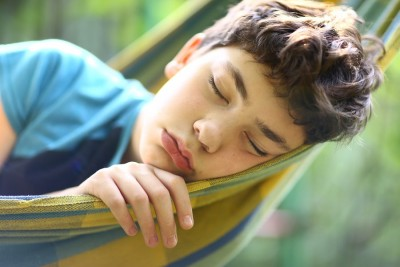 teenager boy sleep resting in hammock