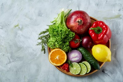 plate of vegetables and fruits on a table