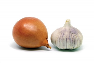 onion and garlic on a white background