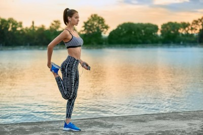 Young woman exercising outdoors in the evening
