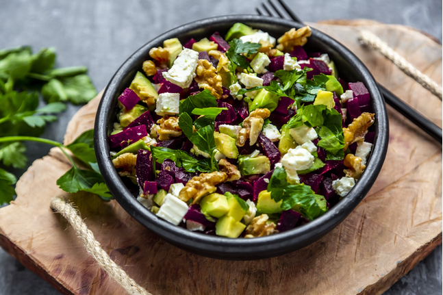 Bowl Of Beetroot Salad With Avocado, Feta, Walnuts And Parsley