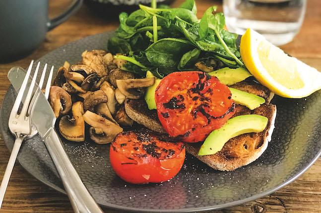 Mushroom, Tomato, Avocado And Greens On Sourdough Toast